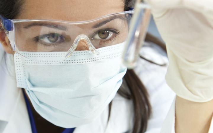 scientist examining liquid sample